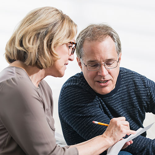Middle-aged couple making financial decision